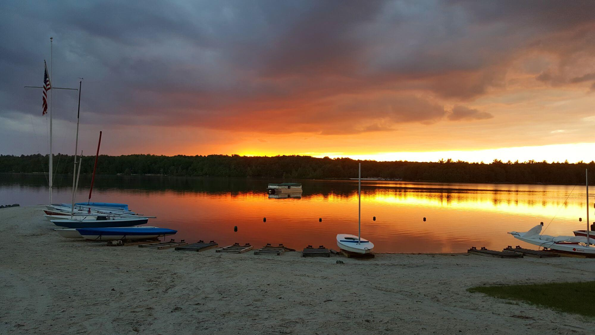 The Sunset over Lake Naomi Club Beach -  Not Far from Feels Like Heaven - A Premium Poconos Vacation Rental