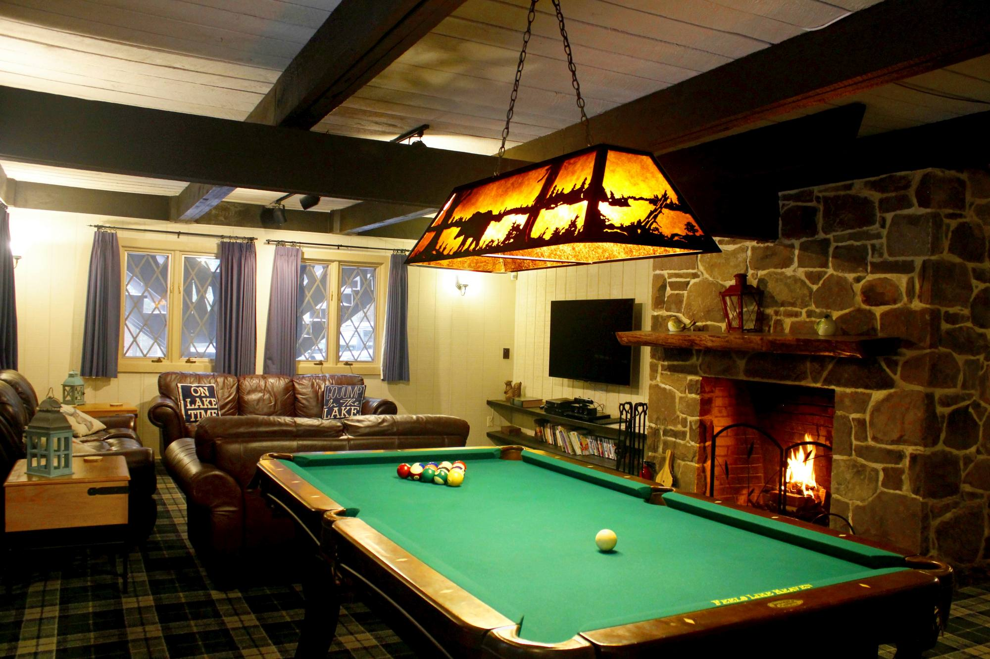 Feels Like Heaven - 5 Bedroom Poconos Vacation Rental House - Family Room / Great room With Large Fireplace Pool Table And 65 Inch TV