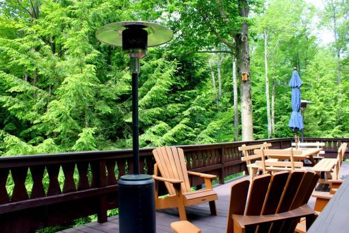 Feels Like Heaven - 5 Bedroom Poconos Vacation Rental - The Huge Second Floor Deck With Propane Heaters and Adirondack chairs