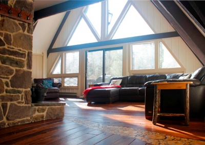 Feels Like Heaven 5 Bedroom Poconos Vacation Rental Wood Floors The Wall Of Windows In The Living Room